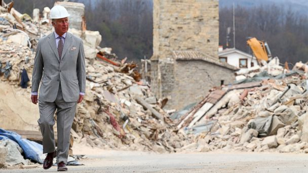 PHOTO: Britain's Prince Charles, Prince of Wales, visits the Italian quake-hit town of Amatrice on April 2, 2017 as part of his European tour aimed at strengthening relations with EU allies post Brexit.