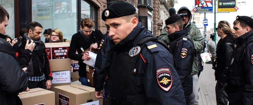 PHOTO: Russian policemen surround Russian gay-rights activists standing next to boxes alledgedly containing signed petitions calling for a probe into a reported crackdown on Chechnyas LGBT community, during a rally in central Moscow, May 11, 2017.
