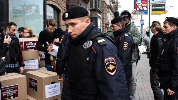 PHOTO: Russian policemen surround Russian gay-rights activists standing next to boxes alledgedly containing signed petitions calling for a probe into a reported crackdown on Chechnya's LGBT community, during a rally in central Moscow, May 11, 2017.