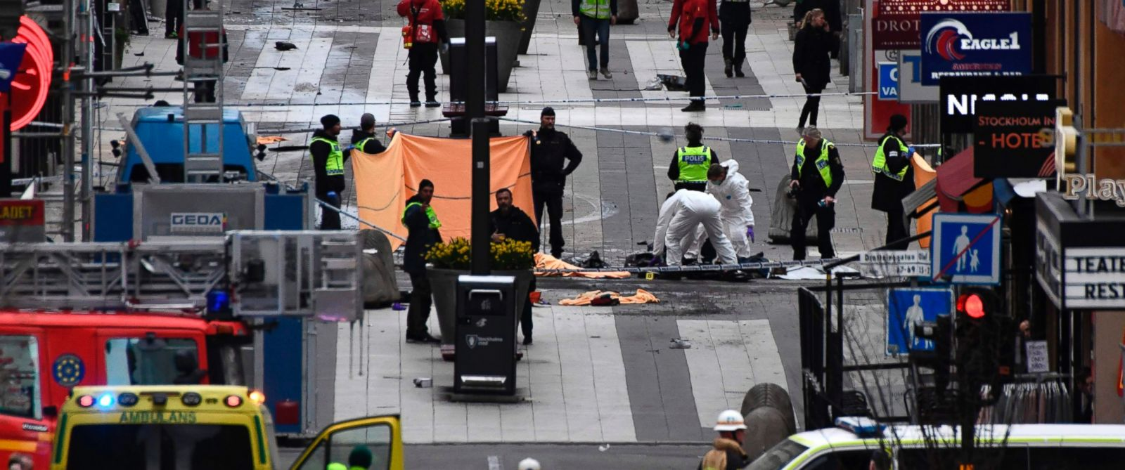 PHOTO: Forensic agents work at the scene where a truck crashed into the Ahlens department store at Drottninggatan in central Stockholm, April 7, 2017.