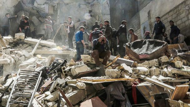 PHOTO: A Syrian mourns as members of the Syrian civil defence volunteers, also known as the White Helmets, and others search for survivors from the rubble following reported air-strikes on the rebel-held town of Saqba, in Eastern Ghouta, April 4, 2017.