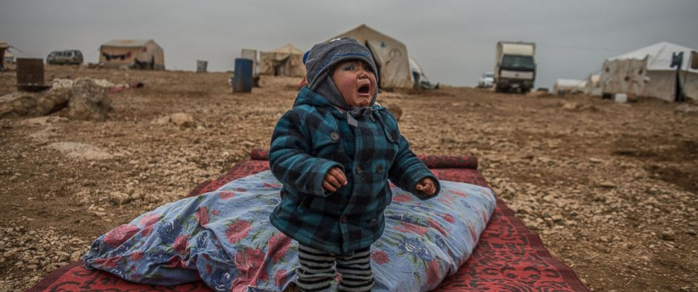 PHOTO: A Syrian baby cries as Syrians live freely against all odds in Jarabulus after its cleansing of Daesh militants as part of Operation Euphrates Shield, in Aleppo, Syria, Dec. 24, 2016.
