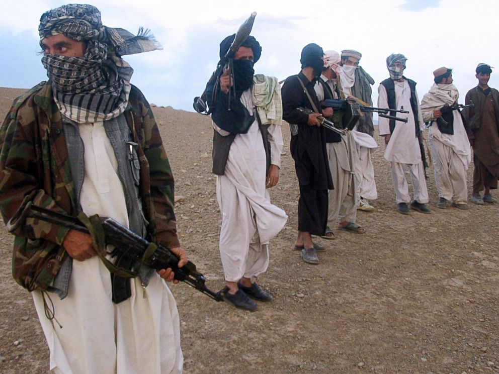PHOTO: Fighters with Afghanistans Taliban militia stand on a hillside at Maydan Shahr in Wardak province, west of Kabul, in this Sept. 26, 2008 file photo.