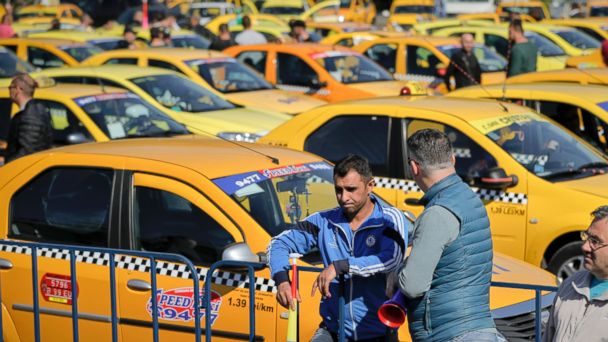 PHOTO: Taxi drivers hold vuvuzelas during a protest outside the government headquarters in Bucharest, Romania, April 26, 2017.