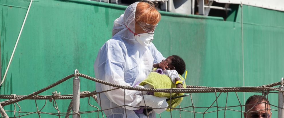 PHOTO: A baby is carried by medical staff out from the Doctors Without Borders (MSF) ship that arrived at the port of Palermo, Italy on Aug. 8, 2015.