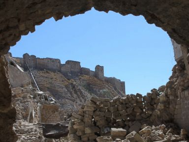 PHOTO: Aleppos citadel is seen through destruction in this picture taken on Sept. 28, 2016 in the Farafira district, northwest of the citys historic citadel, after Syrias army took control of the rebel-held district.