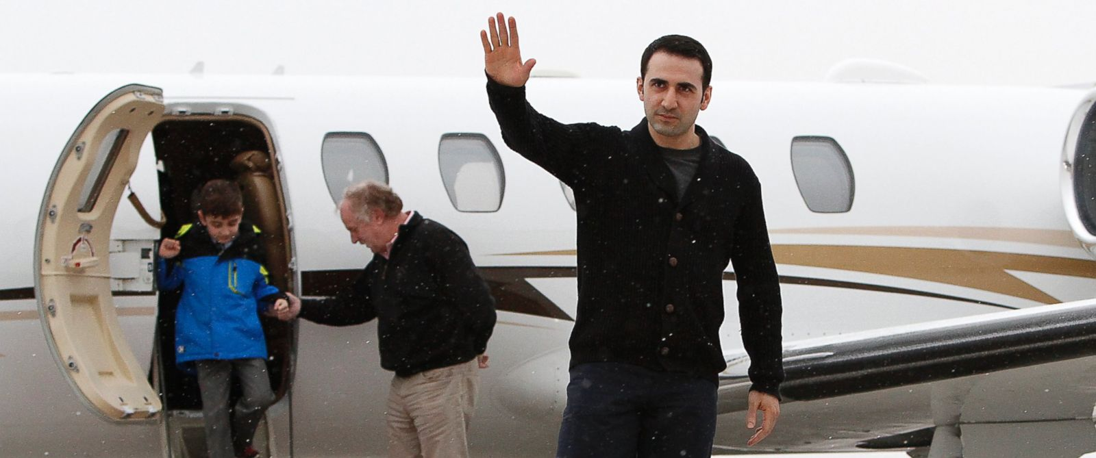 PHOTO: Amir Hekmati, a Marine held in Iran, returns home on January 21, 2016 in Flint, Michigan. Hekmati was released from an Iranian prison this week after being held there since August 2011.