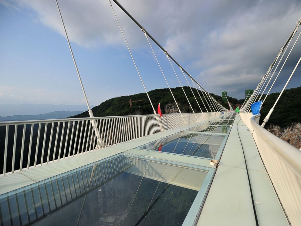 The Longest And Highest GlassBottomed Bridge To Open This Summer - China opens worlds longest skywalk