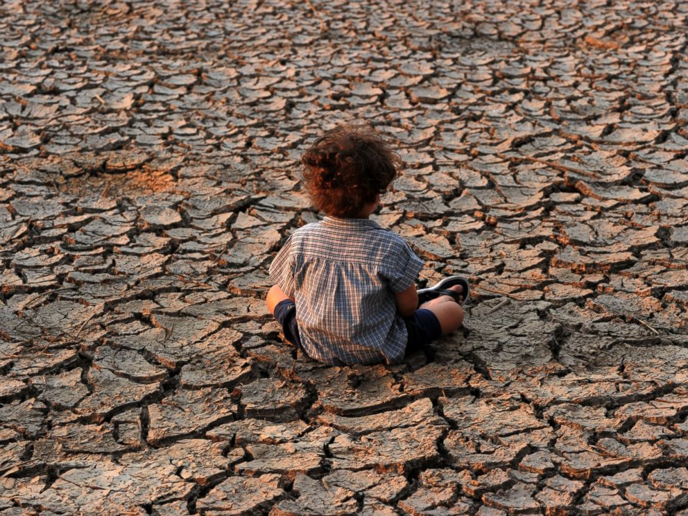 PHOTO: A child remains at an area affected by a drought on Earth Day in the southern outskirts of Tegucigalpa, Honduras, on April 22, 2016.