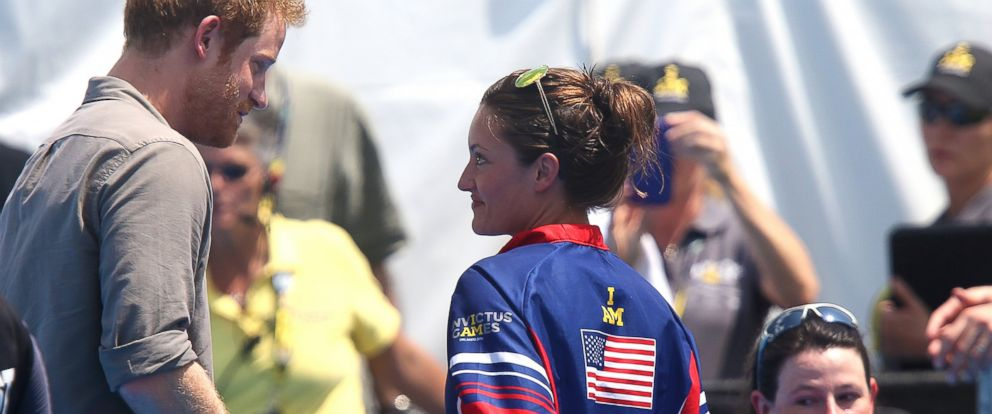 PHOTO: United States Army Sergeant Elizabeth Marks gives her Gold Medal back to Prince Harry to take to the hospital that helped her when she was injured, during the Invictus Games Orlando 2016 Swimming Finals on May 11, 2016 in Lake Buena Vista, Fla.