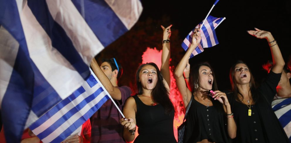 PHOTO: People celebrate in front of the Greek parliament as the people of Greece reject the debt bailout by creditors on July 6, 2015 in Athens, Greece.