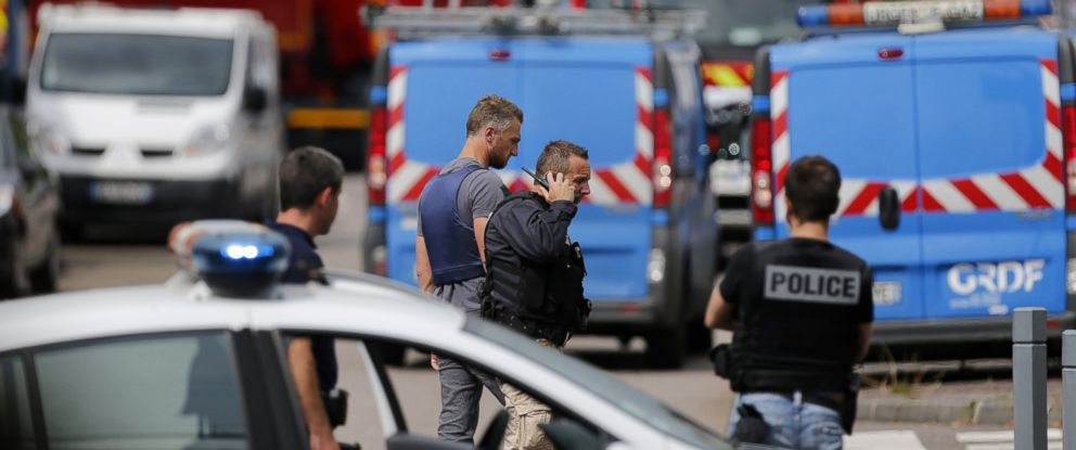 PHOTO: French police officers and firemen arrive at the scene of a hostage-taking at a church in Saint-Etienne-du-Rouvray, northern France, on July 26, 2016 that left the priest dead.