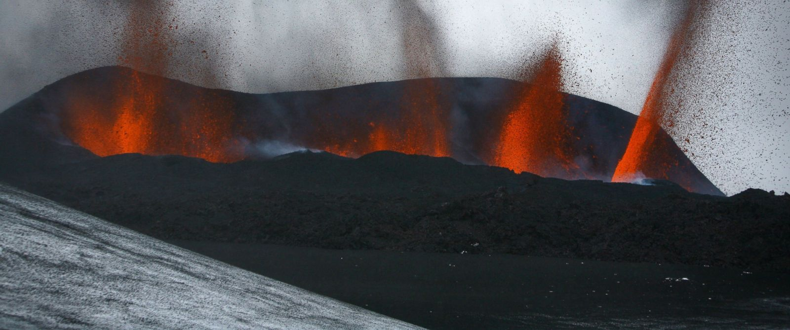 PHOTO: Lava spews out of a mountain in this file photo, March 21, 2010, in Hvolsvollur in the region of the Eyjafjallajokull glacier in Iceland.
