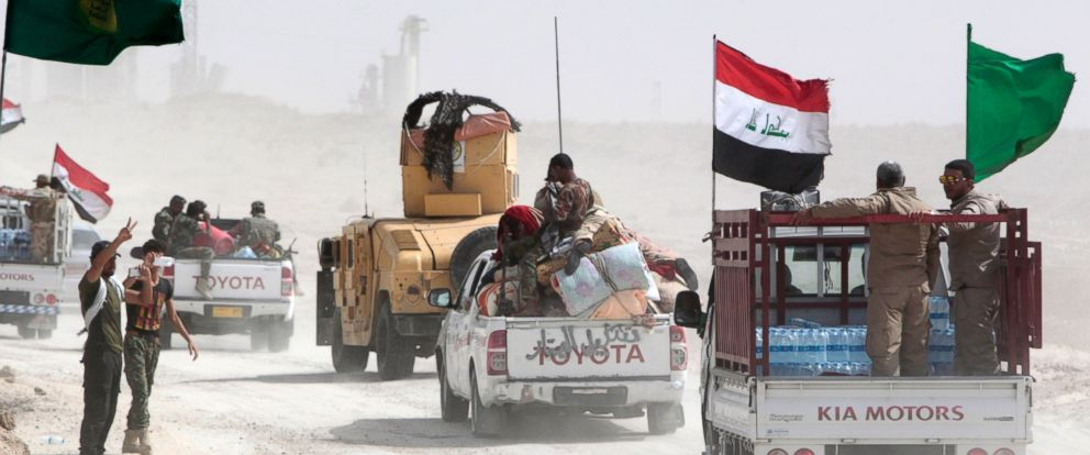 PHOTO: Iraqi pro-government forces drive their vehicles in an area between the village of al-Sejar and Fallujah, on May 28, 2016, as they take part in a major assault to retake the city of Fallujah from the Islamic State (IS) group.
