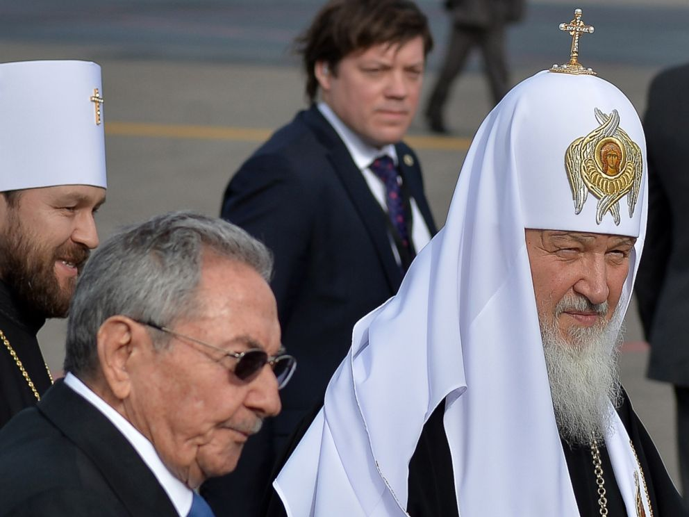 PHOTO: Cuban president Raul Castro, left welcomes Patriarch of Moscow and All Russia and Primate of the Russian Orthodox Church, Kirill, right, upon his arrival at Jose Marti International airport in Havana, on Feb. 11, 2016.