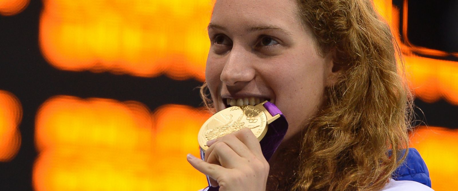PHOTO: Frances gold medalist Camille Muffat celebrates on the podium after winning the womens 400m freestyle swimming event at the London 2012 Olympic Games on July 29, 2012 in London.