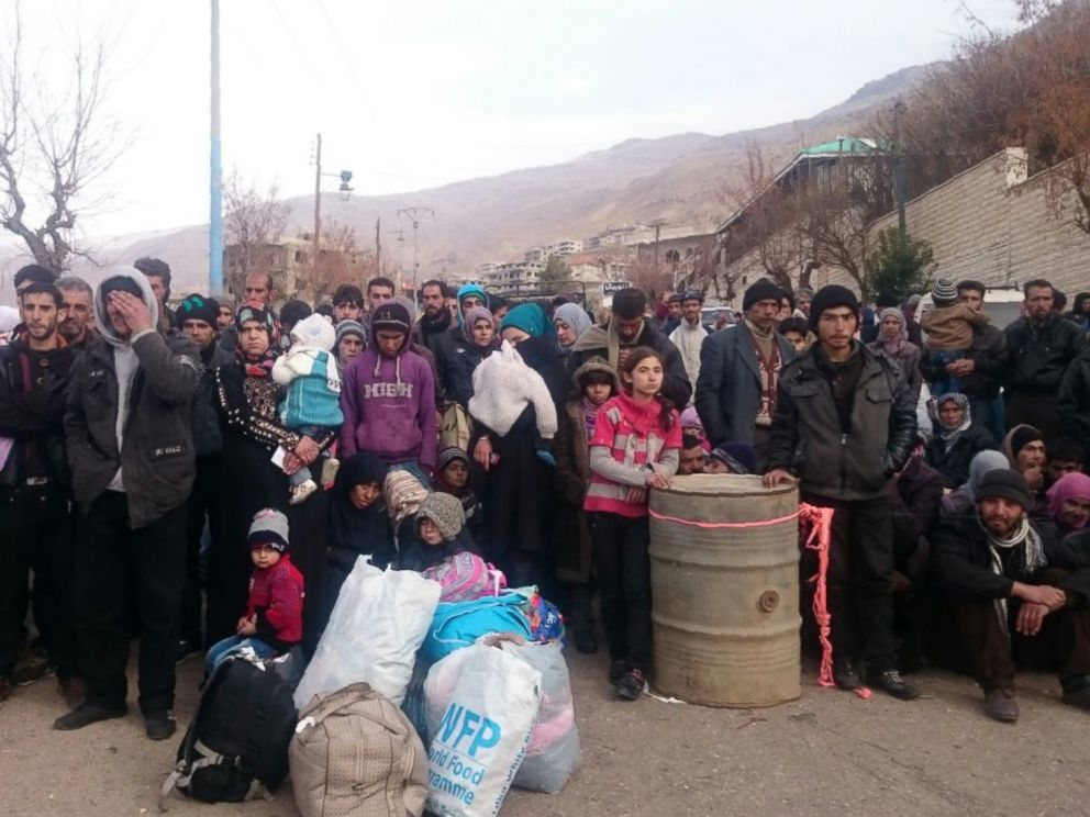PHOTO:Syrians wait for the arrival of an aid convoy in the besieged town of Madaya, Jan. 11, 2016.