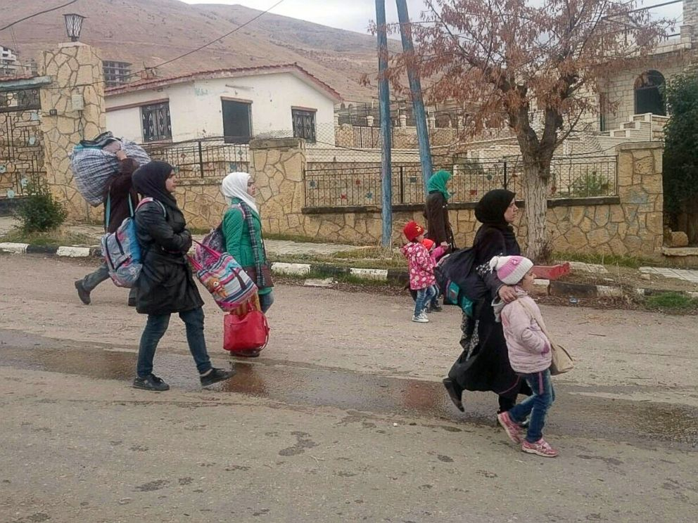PHOTO:Syrians carry their belongings as they leave the besieged rebel-held Syrian town of Madaya, Jan. 11, 2016.