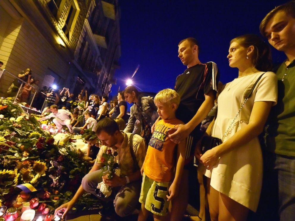 PHOTO: People lay flowers and light candles in front of the Embassy of the Netherlands in Kiev on July 17, 2014, to commemorate passengers of Malaysian Airlines flight MH17 from Amsterdam to Kuala Lumpur which crashed in eastern Ukraine.