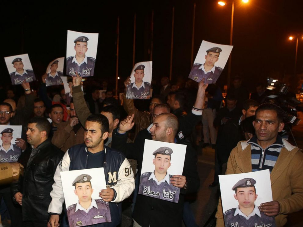 PHOTO: Protestors carry pictures of Muath al-Kaseasbeh, Jordanian pilot who crashed in Syria, at a protest near the Jordanian Prime Minister office in Amman, Jordan, Jan. 27, 2015.