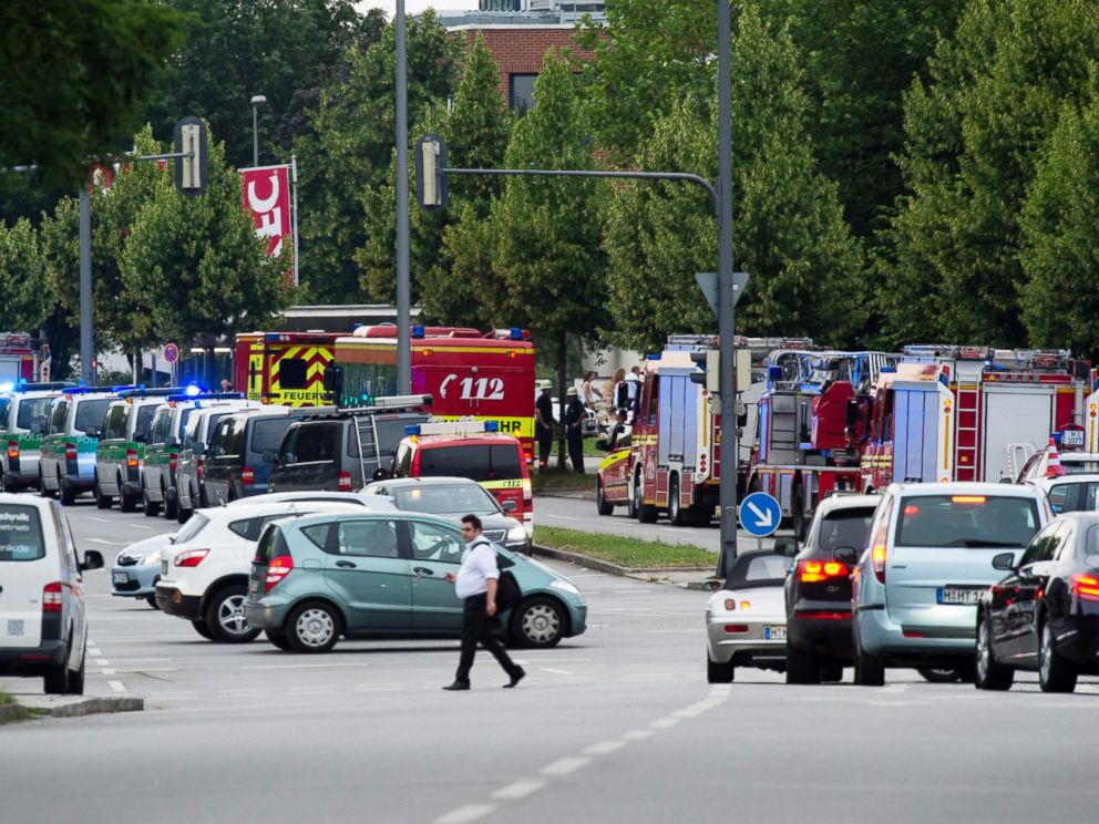 PHOTO: Police and firefighters are seen near a shopping mall amid a shooting on July 22, 2016 in Munich. Several people were killed on Friday in a shooting rampage by a lone gunman in a Munich shopping centre, media reports said.