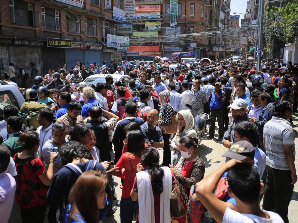 PHOTO: People run into the streets after a magnitude 7.3 earthquake hit Nepal as the country recovers from last months devastating earthquake, in Kathmandu, Nepal, on May 12, 2015.