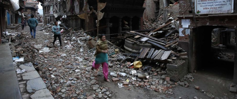 PHOTO: People walk among the debris of houses after a powerful earthquake hits Bhaktapur, Nepal, April 27, 2015.