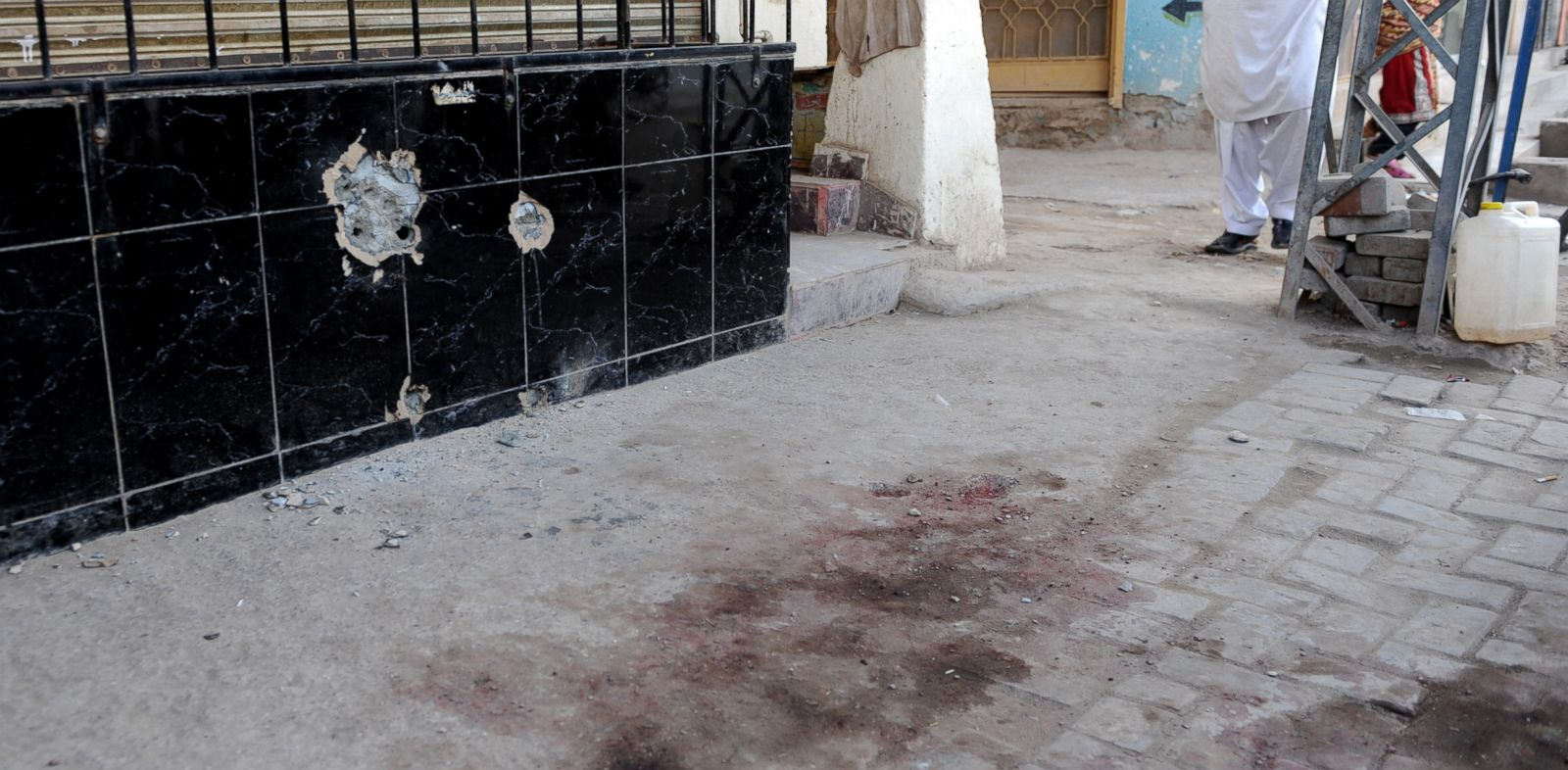PHOTO: The scene with the bullet holes on the wall where Nasiruddin Haqqani, the eldest son of Jalaluddin Haqqani the chief of the Haqqani network is shot dead in Barakahu town near Islamabad, Nov. 10, 2013.