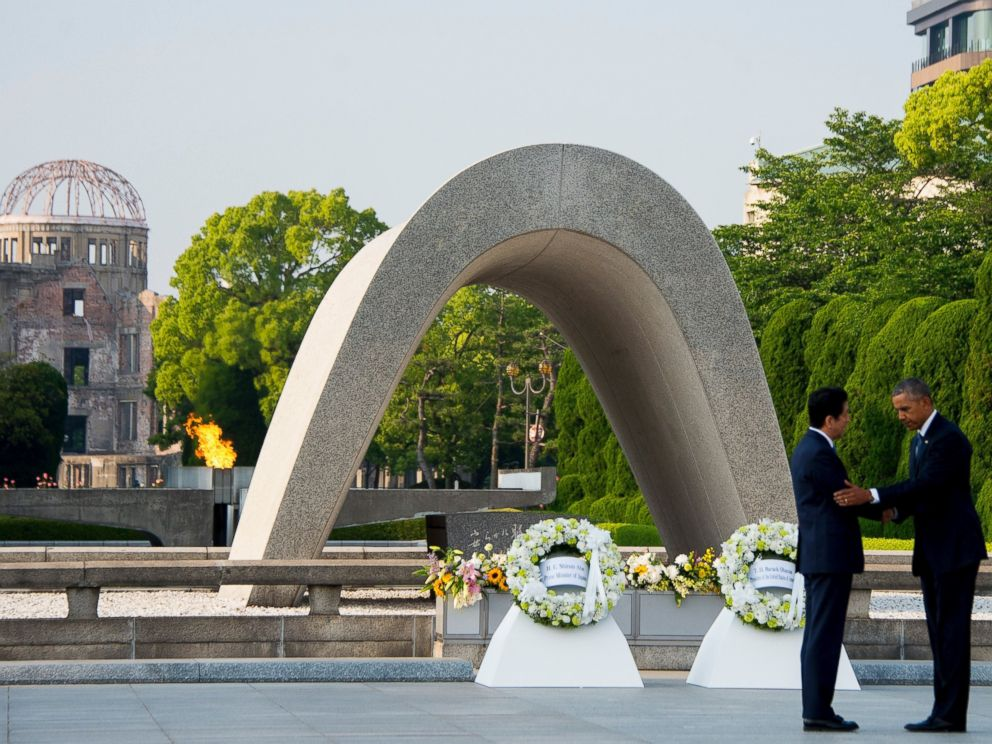 PHOTO: President Barack Obama and Japanese Prime Minister Shinzo Abe shake hands after laying wreaths at the Hiroshima Peace Memorial Park in Hiroshima on May 27, 2016.