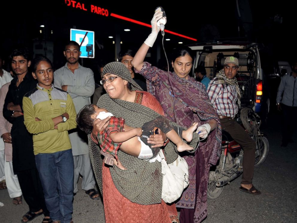 PHOTO: Pakistani relatives bring an injured child to the hospital in Lahore, on March 27, 2016, when an apparent suicide bomb ripped through the parking lot of a crowded park in the Pakistani city of Lahore where Christians were celebrating Easter.