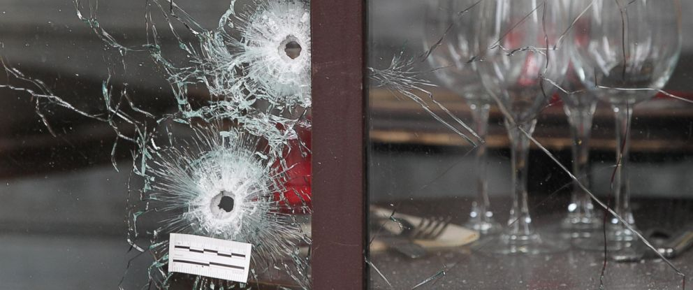 "PHOTO: Bullet holes are seen as the French police takes security measures at Bataclan concert hall and ""La Belle Equipe"" restaurant in 11th district of Paris on Nov. 14, 2015 following the terror attacks."
