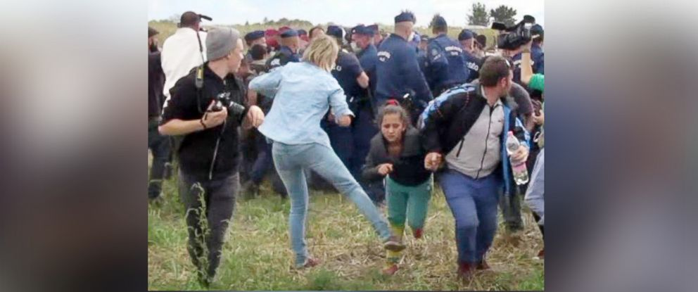 PHOTO: This video grab made on Sept. 9, 2015 shows a Hungarian TV camerawoman kicking a child as she runs with other migrants from a police line during disturbances at Roszke, Hungary.