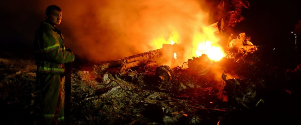 PHOTO: A firefighter stands as flames burst amongst the wreckages of the Malaysia airliner carrying 298 people from Amsterdam to Kuala Lumpur after it crashed, near the town of Shaktarsk, in rebel-held east Ukraine, on July 17, 2014.