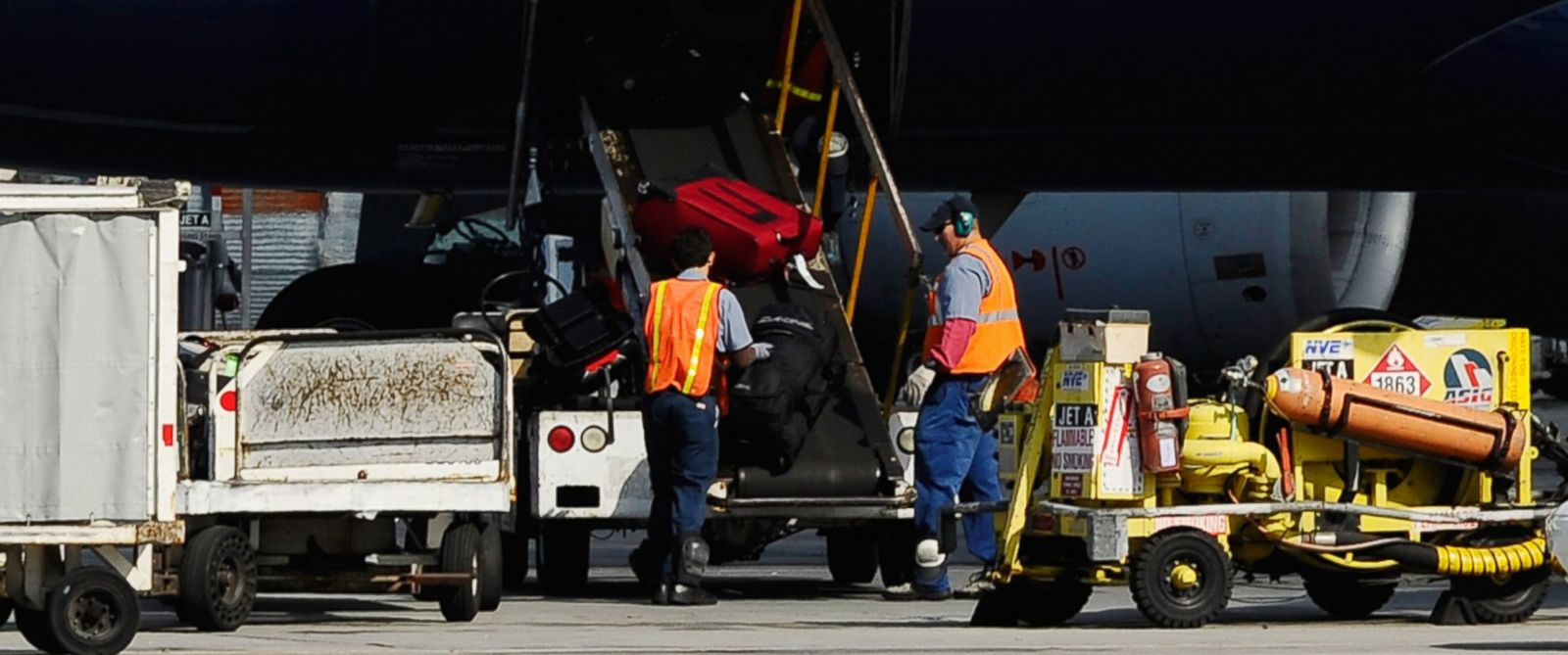 PHOTO: Airline workers load luggage and cargo into a US Airways passenger plane at Los Angeles International Airport on Oct. 30, 2010 in Los Angeles, Calif.