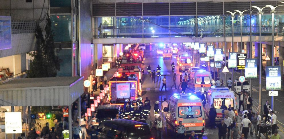 PHOTO: Ambulances and police set up a perimeter after two explosions followed by gunfire hit Turkeys biggest airport, Ataturk in Istabul, June 28, 2016.