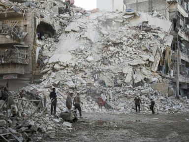 PHOTO: Members of the Syrian Civil Defense, known as the White Helmets, search for victims amid the rubble of a destroyed building following reported air strikes in the rebel-held Qatarji neighborhood of the northern city of Aleppo, Oct. 17, 2016.
