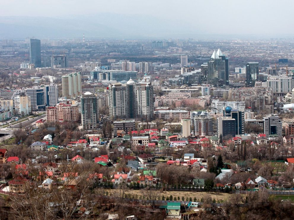 PHOTO: High and low rise buildings stand on the city skyline in Almaty, Kazakhstan, April 9, 2012.