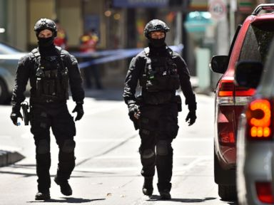 PHOTO: Australian SWAT police are seen after a car ploughed into pedestrians in the centre of Melbourne on January 20, 2017.