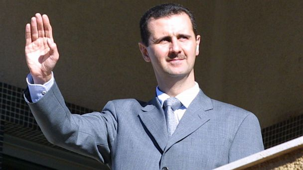 PHOTO: Bashar al-Assad waves from the balcony of al-Rawdha presidential palace in Damascus, March 2003, to Lebanese protesters.