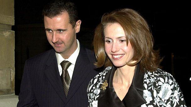 PHOTO: Bashar Al-Assad and his wife Asma Assad arrive for a dinner hosted by Britains Lord Chancellor, Lord Irvine of Lairg, at Lancaster house in central London, December 2002.