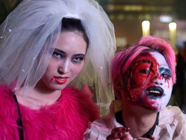 PHOTO: People in costume pose for photos as they celebrate Halloween in Beijing, Oct. 31, 2013.