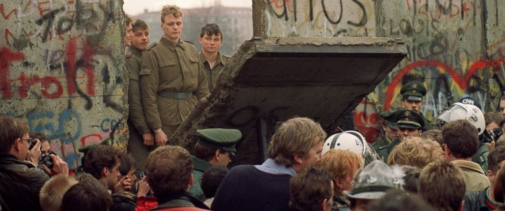 PHOTO: West Berliners crowd in front of the Berlin Wall, Nov. 11, 1989, as they watch East German border guards demolishing a section of the wall in order to open a new crossing point between East and West Berlin.