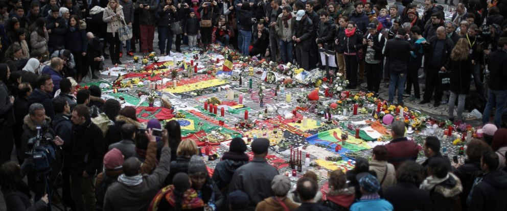 PHOTO: A large crowd of people view tributes at Place De La Bourse in honor of the victims of yesterdays terror attacks, March 23, 2016, in Brussels.