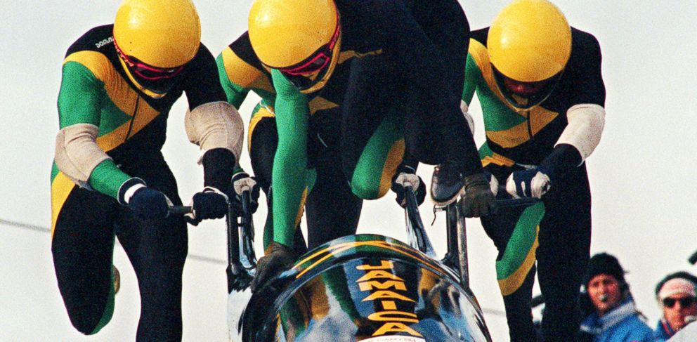 PHOTO: Jamaican four-man bobsleigh pilot Dudley Stokes jumps in as his three teammates push off at the start of the second run of the Olympic four-man bobsleigh event Feb. 27, 1988, in Calgary.