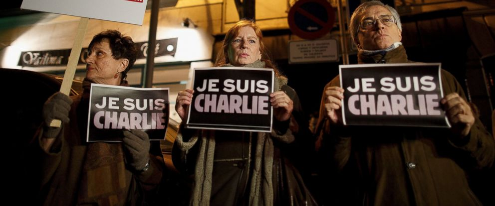 "PHOTO: People hold signs reading ""Je Suis Charlie"" in front of the Embassy of France on Jan. 7, 2015 in Madrid, Spain."