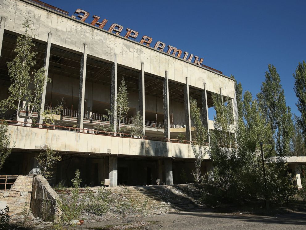 PHOTO: The abandoned Energetik cultural center, that once housed a library, lecture halls and sports facilities, stands on the former main square overgrown with trees, Sept. 30, 2015 in Pripyat, Ukraine.