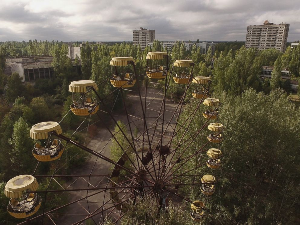 PHOTO: In this aerial view, an abandoned ferris wheel stands on a public space overgrown with trees in the former city center, Sept, 30, 2015 in Pripyat, Ukraine.