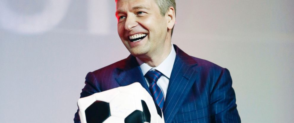 PHOTO: Monacos football club president Dmitriy Rybolovlev laughs as he holds a present given by Princes Albert II of Monaco during a ceremony to celebrate the end of the 2012-2013 football season, May 31, 2013 in Monaco.