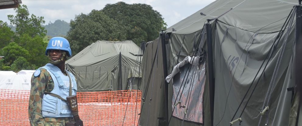 PHOTO: An UN soldier stands in front of a tent in the new Ebola Treatment Center built by the United States army, Nov. 10, 2014, in Tubmanburg, Liberia.