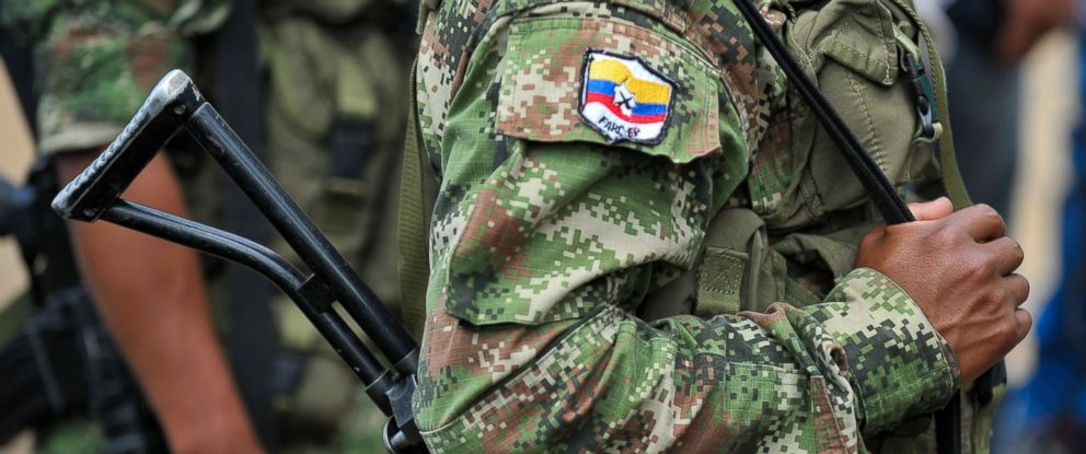 PHOTO: Members of the Revolutionary Armed Forces of Colombia (FARC) guerrillas, guard the mountainous region of the department of Cauca, Feb. 15, 2013.